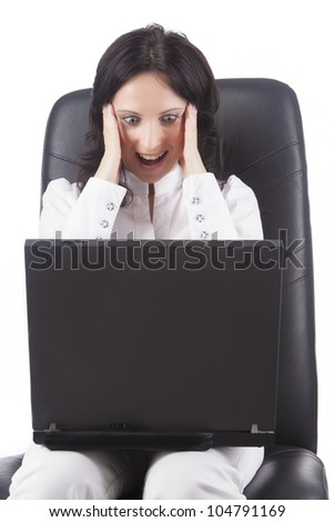portrait of a young beautiful caucasian woman sitting on chair with a laptop and having fun, isolated over white background - stock photo