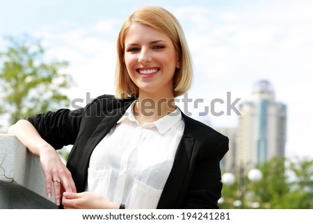 Portrait of a young beautiful cheerful woman - stock photo