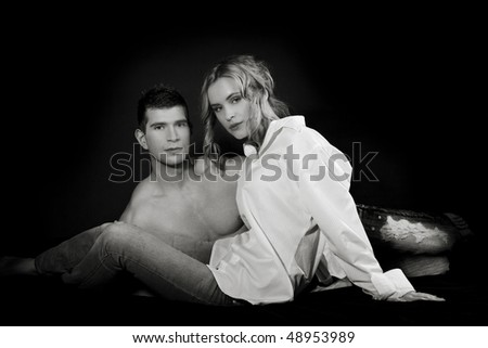 Portrait of a young beautiful couple, attractive people in BW - stock photo