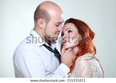 Portrait of a young beautiful couple in studio - stock photo