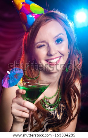 Portrait of a young beautiful girl in a cover on a holiday - stock photo
