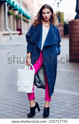 Portrait of a young beautiful girl in fashionable clothes, lifestyle - stock photo