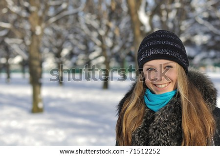 Portrait of a young beautiful girl in the park