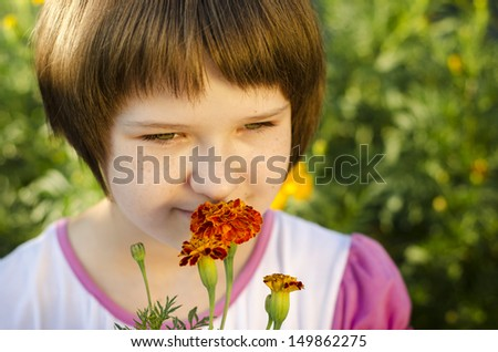 Portrait of a young beautiful girl on flower background