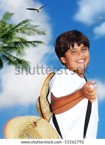 Portrait of a young beautiful happy boy over blue sky - stock photo