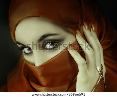 Portrait of a young  beautiful muslim woman - stock photo