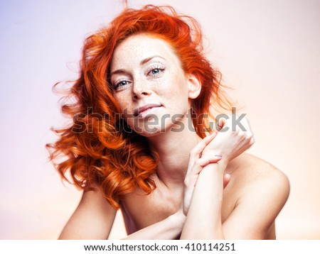 Portrait of a young beautiful redhead woman - stock photo