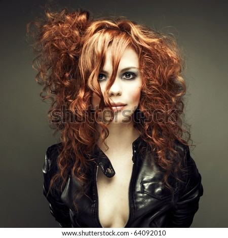 Portrait of a young beautiful redheaded girl - stock photo
