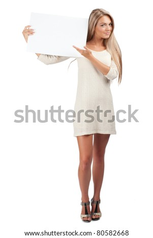 Portrait of a young beautiful woman holding a blank signboard, isolated on white background - stock photo