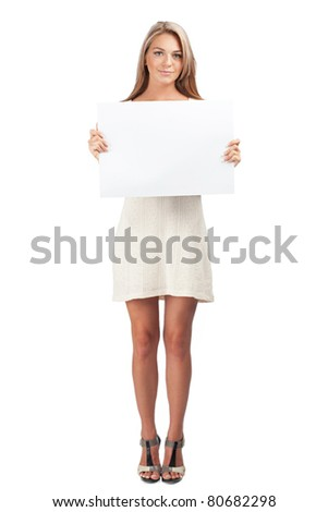 Portrait of a young beautiful woman holding a blank signboard, isolated on white background