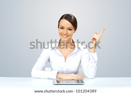 POrtrait of a young beautiful woman in business wear at work - stock photo