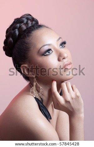 Portrait of a young beautiful woman, isolated on pink - stock photo