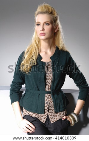 Portrait of a young beautiful woman posing on light background - stock photo