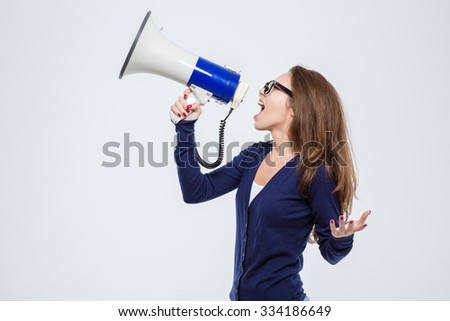 Portrait of a young beautiful woman shouting in loudspeaker isolated on a white background - stock photo