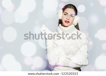 portrait of a young beautiful woman winter look. - stock photo