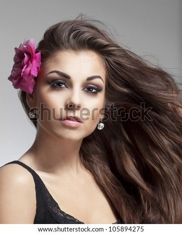 portrait of a young beautiful woman with brown hair looking - stock photo