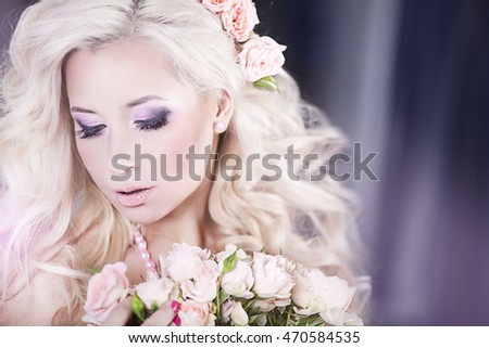 Portrait of a young beautiful woman with curly blond hair flying in her dreams
