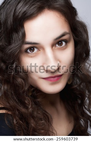 Portrait of a Young Beautiful Woman with Long Brown Hair and Brown Eyes - stock photo
