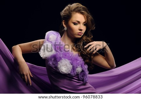 Portrait of a young beauty girl in blue dress - stock photo