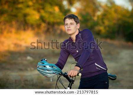portrait of a young bicyclist in helmet