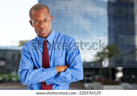 Portrait of a young black businessman outdoor - stock photo