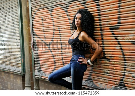 Portrait of a young black woman, model of fashion in urban background - stock photo