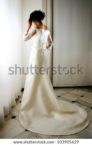 Portrait of a Young black woman, model of fashion, wearing a wedding dress - stock photo