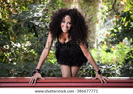 Portrait of a young black woman smiling with braces in urban park. - stock photo