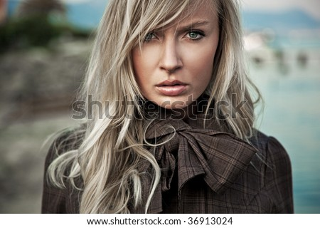 Portrait of a young blond lady - stock photo