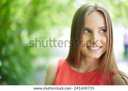 Portrait of a young blond outdoors - stock photo