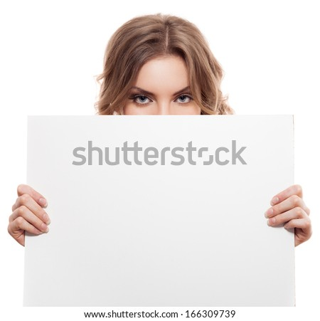 Portrait of a young blond woman holding a white blank banner. Isolated - stock photo