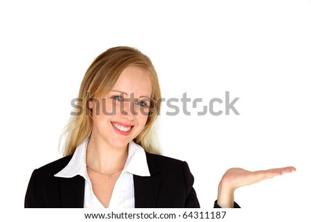 Portrait of a young blonde businesswoman, with her hand outstretched, as though she is presenting something. - stock photo