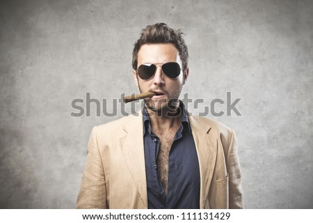 Portrait of a young boss smoking a cigar - stock photo