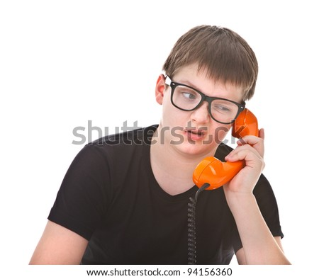 Portrait of a young boy getting bored during phone call - stock photo