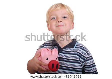 Portrait of a young boy holding his pink piggybank - stock photo