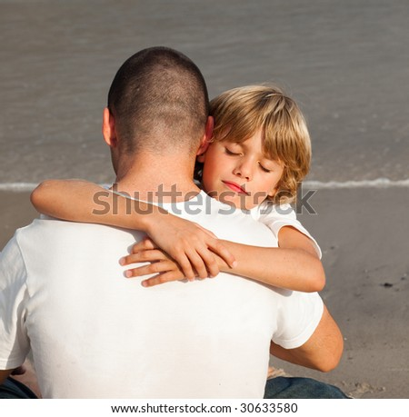 Portrait of a Young Boy Hugging his father - stock photo