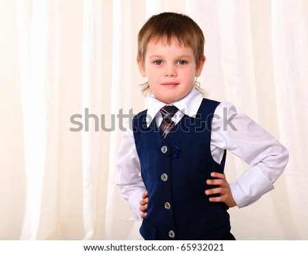 Portrait of a young boy in a blue vest