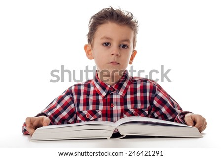 portrait of a young boy in shirt with a big book
