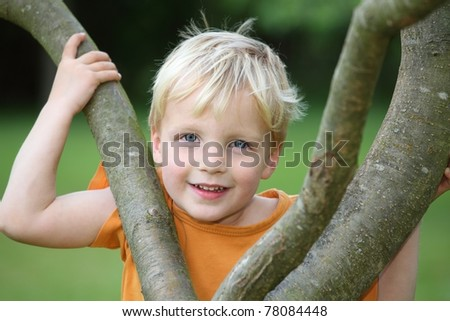 Portrait of a young boy in the garden - stock photo