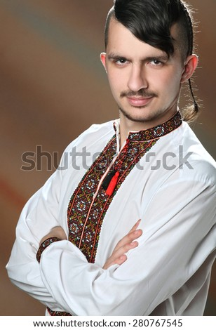 portrait of a young boy in the Ukrainian embroidered shirt. national dress. Ukrainian Cossack - stock photo
