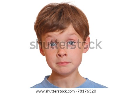 Portrait of a young boy making a funny face with eyes wide open - stock photo