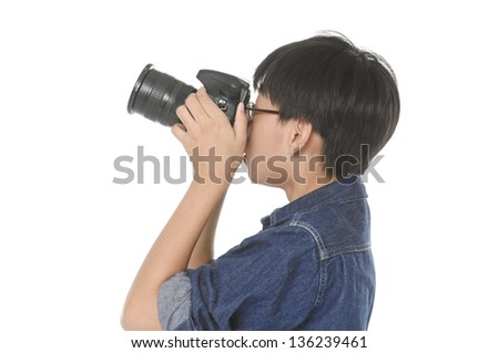 Portrait of a young boy photographer holding a photo camera - stock photo