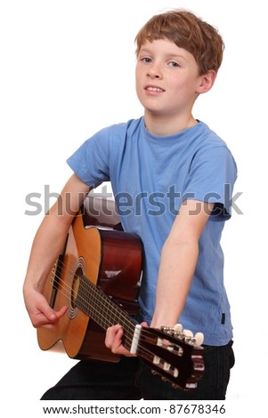 Portrait of a young boy playing a classical guitar - stock photo