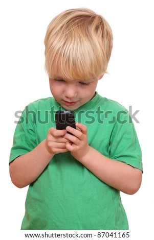 Portrait of a young boy playing with his new cell phone - stock photo