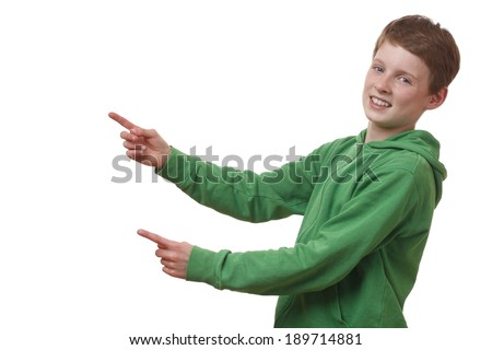 Portrait of a young boy pointing up on white background - stock photo