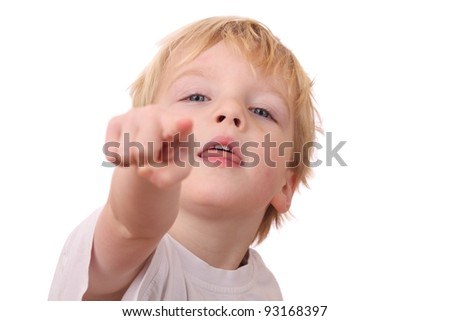 Portrait of a young boy pointing with his finger - stock photo