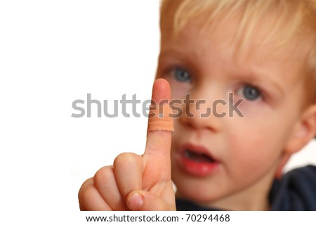 Portrait of a young boy showing a plaster on his injured finger - stock photo