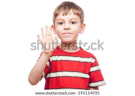 portrait of a young boy waving on white background - stock photo