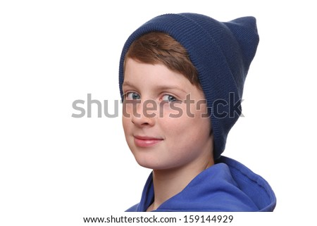 Portrait of a young boy wearing a woolen hat on white background - stock photo