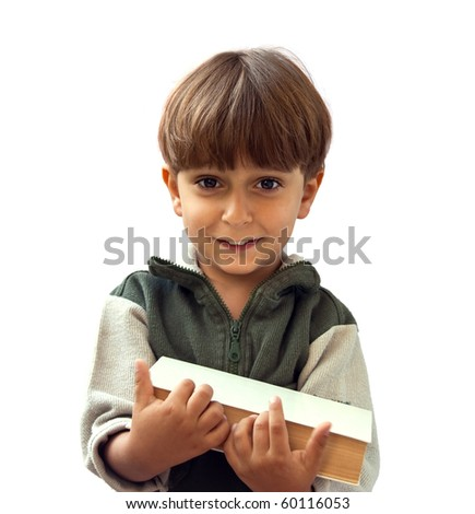 Portrait of a young boy with a book in his hand. - stock photo
